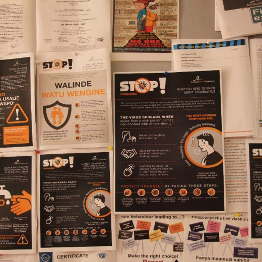 Notice board with COVID-19 awareness posters