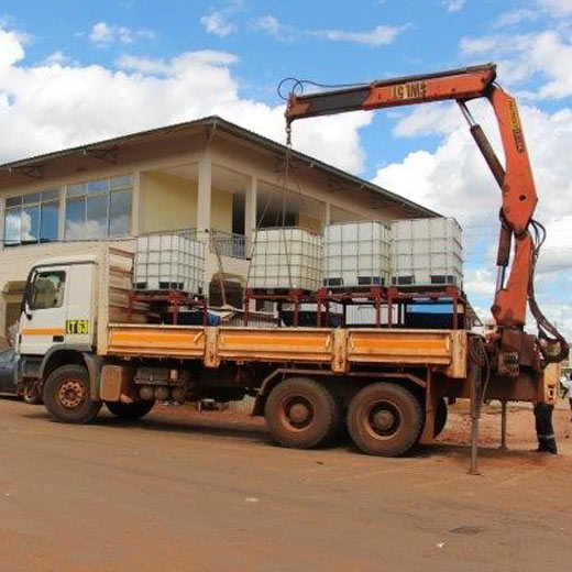 A truck off-loading one of the 10 tanks donated by the mine for people in Geita Town to wash their hands.